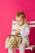 Little girl in a beautiful dress with a bag — Stock Photo
