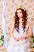 Young girl with long hair in  with white rabbit — Stock Photo