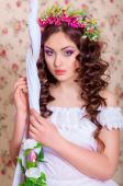 Girl with long hair in a wreath — Stock fotografie