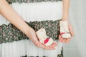 Baby socks in  hands of pregnant woman — Stock Photo