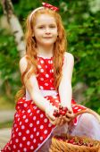 Girl in a dress with a basket of cherries — Stock Photo