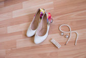 Wedding shoes bracelet and earrings, a necklace — Stock Photo