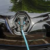 Charging modern electric car with power supply plugged in — Foto de Stock