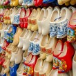 Traditional Dutch clogs wooden shoes in souvenir store Amsterdam — Stock Photo #54766811