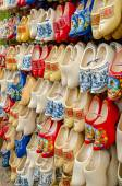 Traditional Dutch clogs wooden shoes in souvenir store Amsterdam — Stok fotoğraf