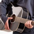 Close up of hands learning to playing an acoustic guitar — Stock Photo #58720985