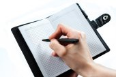 Hand write on notebook on white background — Stock fotografie