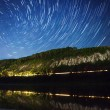 A beautiful night sky, the Milky Way, spiral star trails and the trees — Stock Photo #58812137