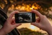 Woman taking snapshot with smartphone — Stock Photo