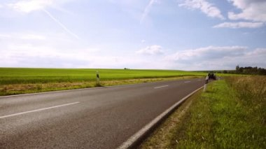 Street going through farmland in Hessen — Stockvideo