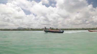Guys on fast boat near island — Stock Video
