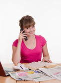 The girl calls by phone number from telephone directory — Stock Photo