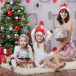 Family with gifts at Christmas tree — Stockfoto #56656267