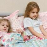 Two girls sick meryat temperature — Stock Photo #63266095