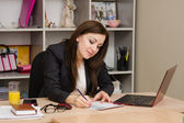 Business woman at the desk — Stock Photo