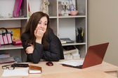 Woman shock in front of computer — Stock Photo