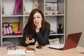Office worker made a mistake and frightened keeps your phone — Stock Photo