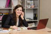 Girl and office talking on phone looking into frame smiling — Stock Photo