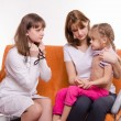 Pediatrician ready to test breath stethoscope a little girl with her mother — Stock Photo #66160364