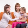 Pediatrician checks breath stethoscope a little girl in the arms of mother — Stock Photo #66160468