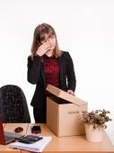 Dismissed girl in office wipes tears and collects things — Stock Photo