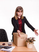 Girl in office grotyagivaet hands to indoor potted tsvutku — Stock Photo