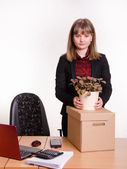 Girl in office about desktop keeps indoor potted plant — Stock Photo