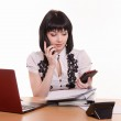 Call-center worker talking on phone and looking at the other — Stock Photo #69170673