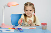 Six year old girl dunks brush in the paint — Stock Photo