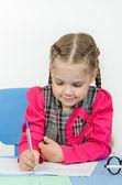 Schoolgirl wrote in a notebook — Stock Photo