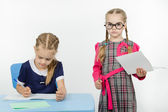 Severe teacher standing at the student — Stock Photo