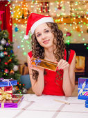 Beautiful girl writing a list of gifts — Stock Photo