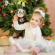 Three year old girl playing Christmas balls — Stock Photo #78293732