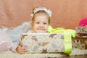Happy little girl with a big Christmas gift — Stock Photo