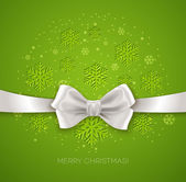 Green Christmas background ribbon with white silk bow — Stock Vector