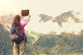 Woman hiker in taking photo — Stockfoto
