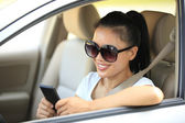 Woman driver use her cell phone in car — Stock Photo