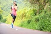 Runner athlete running on forest trail — Stock Photo