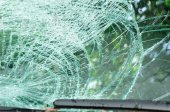 Broken windshield of car by typhoon — Stock Photo