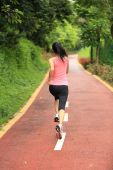 Woman running at forest trail — Stock Photo