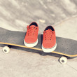 Skateboard and sneakers at skatepark — Stock Photo #54161779