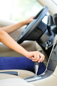 Woman driver shifting the gear stick — Stock Photo