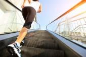 Runner athlete running on stairs.pt. — Stock Photo