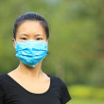 Asian woman wear face mask — Stock Photo #54943121