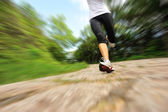 Woman legs running at forest trail — Stock Photo