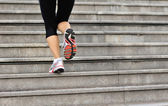 Woman legs running up on stone stairs — Stock Photo
