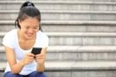 Beautiful young asian woman using smart phone — Stock Photo