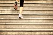 Woman legs running up — Stock Photo