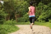 Athlete running on  road — Stock Photo