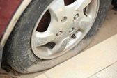 Flat tire on car wheel — Stok fotoğraf
